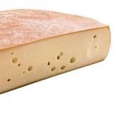Raclette-Käse gehört zu dem Raclette-Grill dazu. Leckeren Raclette-Käse auf dem Raclette-Grill zubereiten.